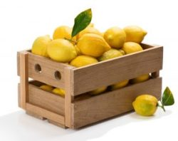 Wooden box full of fresh lemons