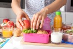 Young woman packing school lunch