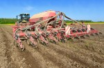 Planting corn trailed planter in the field