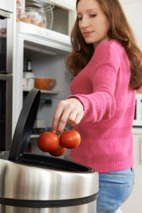throwing-away-out-of-date-food-in-refrigerator