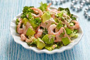 Fresh green salad with shrimp and avocado