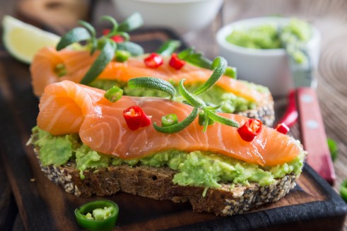 Whole grain bread with avocado paste and salmon