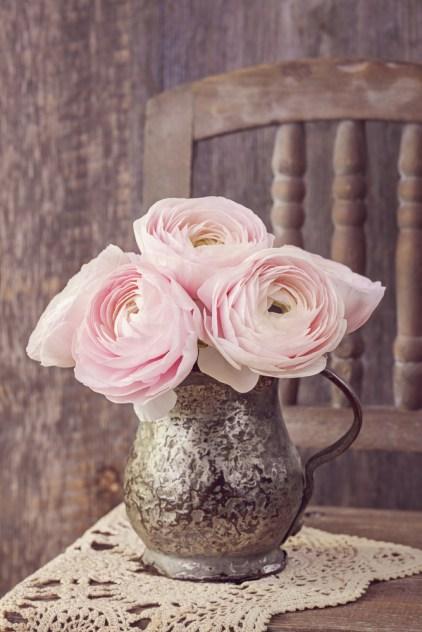 Ranunculus flowers in an old vase