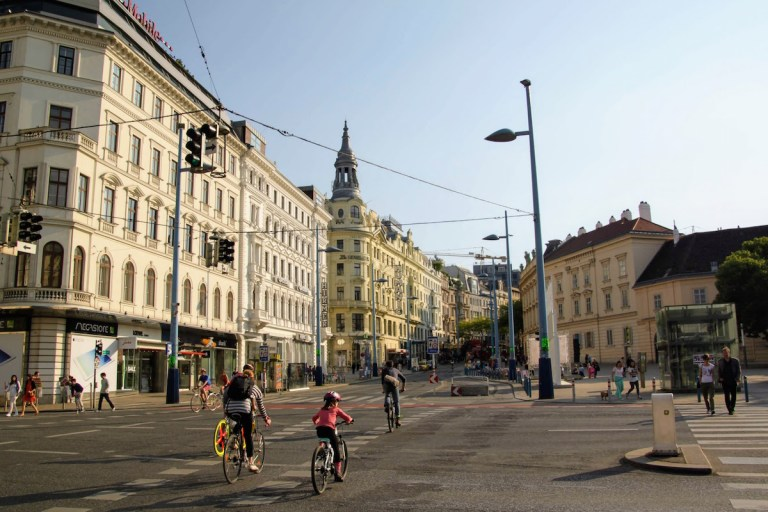 City streets of Vienna with cyclists and pedestrians.
