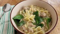 ground turkey soup with noodles in a bowl