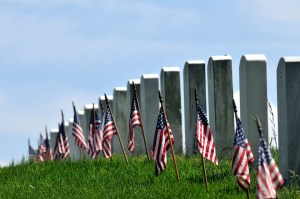 Cemetery headstones and flags