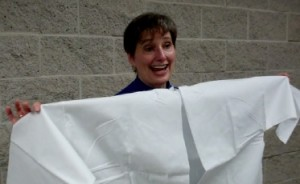 Gail Rubin displays Jewish burial garments in her talk.