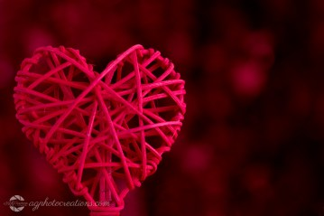 Red Woven Heart on Red Background with Copy Space