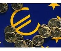 monedas de un euro y simbolo de la moneda