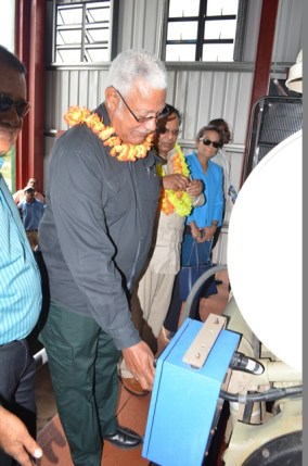 Minister of Agriculture Noel Holder checks out a piece of equipment in the pump station