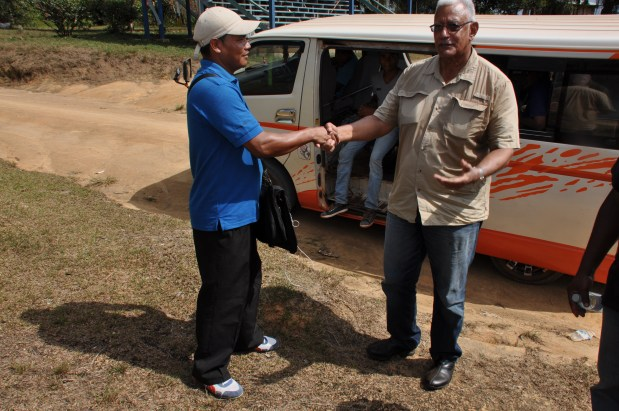 Hon. Noel Holder, Minister of Agriculture, meeting with Mr. Cleveland De Souza, Toshao of White Water Creek village.