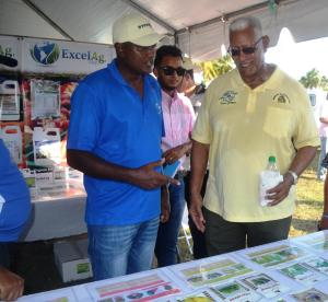 agriculture-minster-noel-holder-while-visiting-one-of-the-booths-at-world-food-day