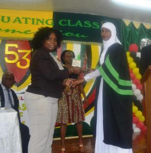 Permanent Secretary (ag), Mrs. Joylyn Nester Burrows presents the best graduating student award to Ms. Narifa Mokhan
