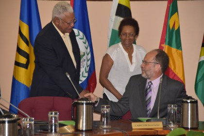 Minister Holder greets CARICOM Secretary General, Ambassador Irwin La Roque as 71st Special Meeting of COTED opens..