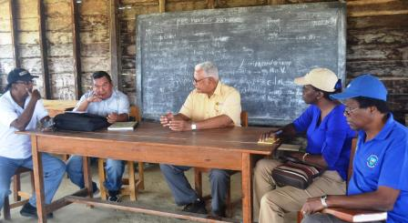 Minister Holder, Permanent Secretary, Delma Nedd and other heads of departments during a village meeting in Kamana Village