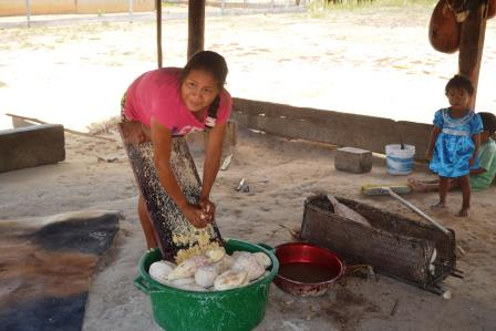 One of the villagers grating cassava at Monkey Mountain