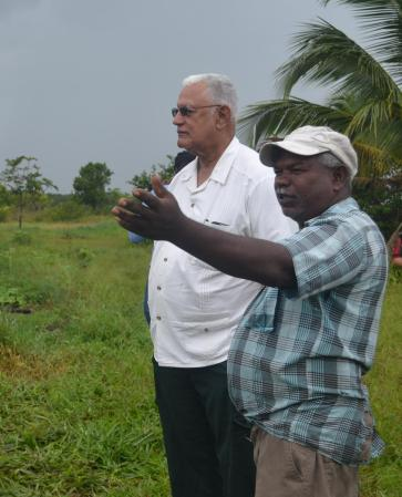 Minister Holder and Mr. Balram Bridgewater on his farm