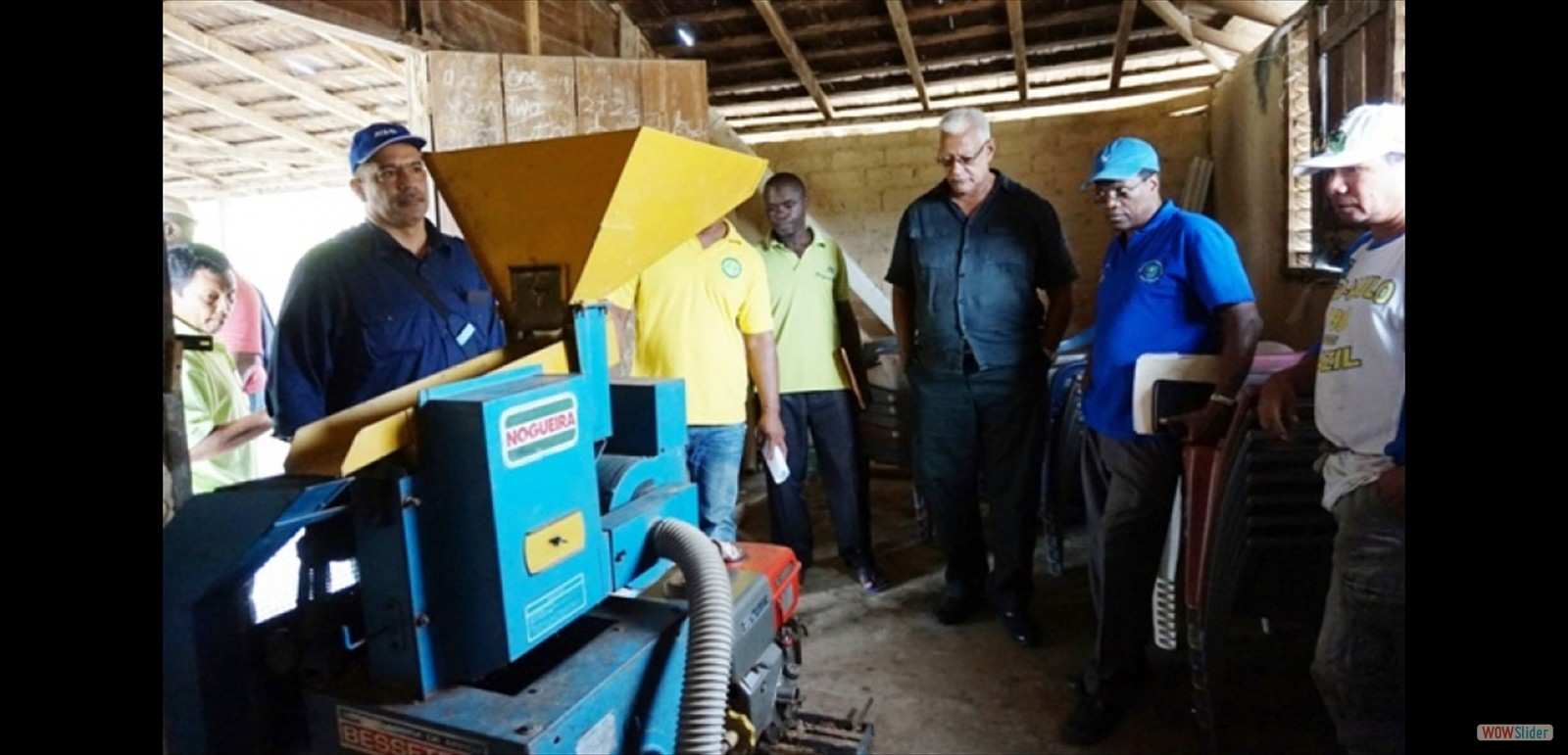 Minister of Agriculture Noel Holder and other officials examine rice milling machine during visit in region 8
