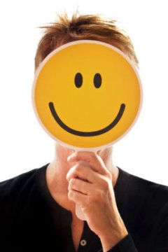 Grin and bear it: Smiling facilitates stress recovery