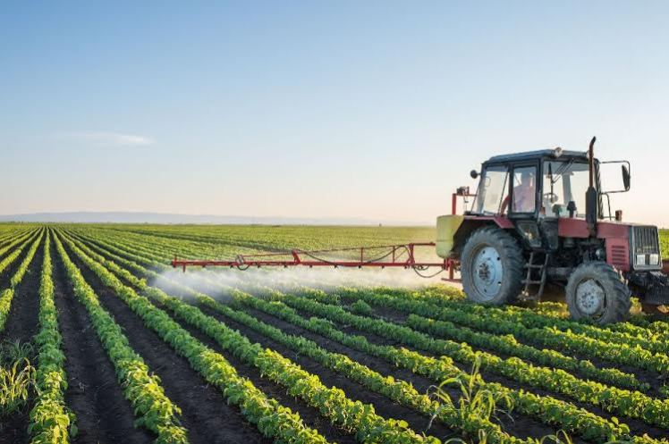40569158 - tractor spraying soybean field at spring