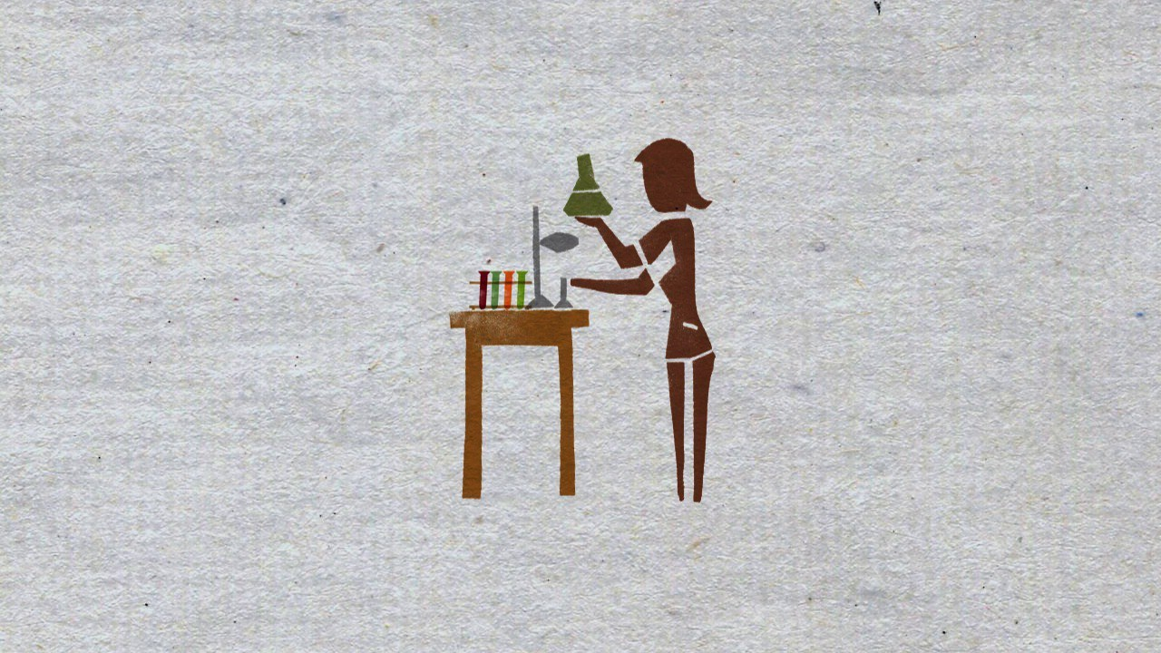 paper cutout of a woman holding vegetables