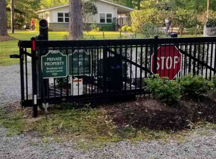 Sliding Gate Entrance with a Telephone Access System for a Neighborhood Subdivision.