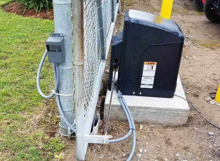 Chain Link Fence with Solar Panel. Powered by Lift Master.