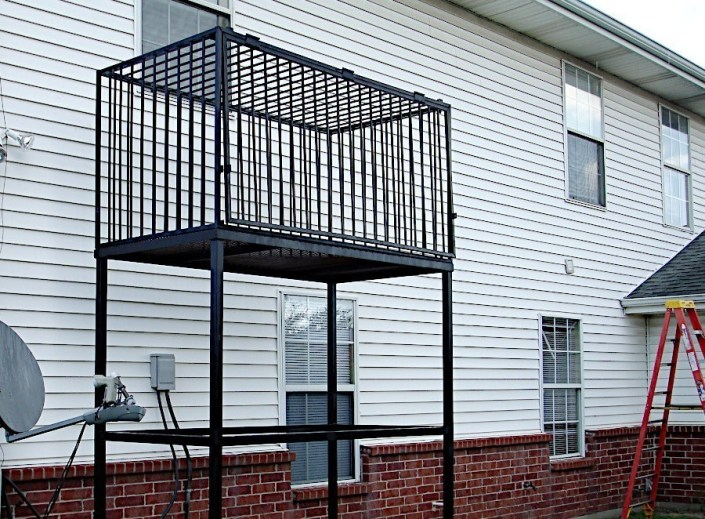 Iron Structure in New Orleans Designed to Secure Air Conditioner Condensers.