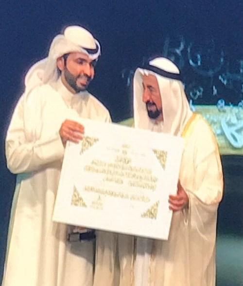 Abdullah Al-Busais receiving the Best Arabic Novel Award at the 2017 Sharjah Book Fair (Abdullah Al-Busais)
