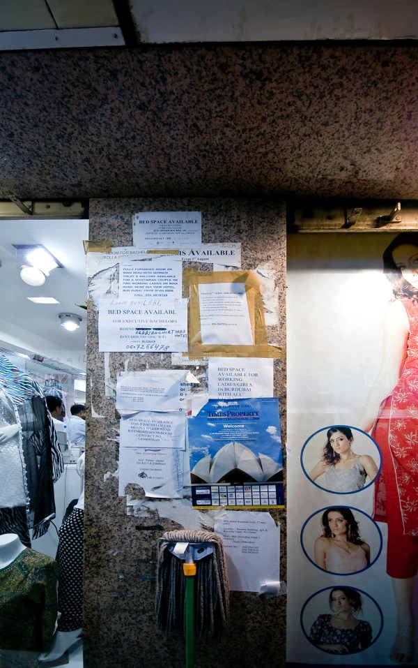 Flyers on a wall ad­­vertising room rentals in Dubai