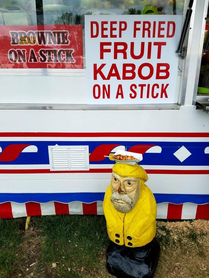 Captain Ahab of Ahab's Adventures eating fair food at the Iowa State Fair 2016