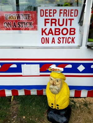 Captain Ahab of Ahab's Adventures eating fair food at the Iowa State Fair 2016