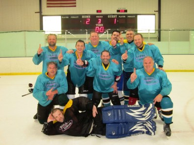 Tom & Mike Napholz in their league championship team photo in June, 2017. Mike is on the bottom right, Tom is on the bottom left. Photo courtesy of Mike Napholz.