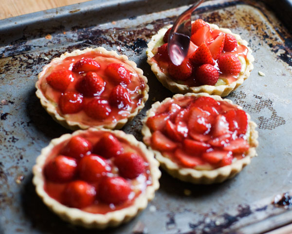 strawberry pistachio custard tartlets blind filling tart cases