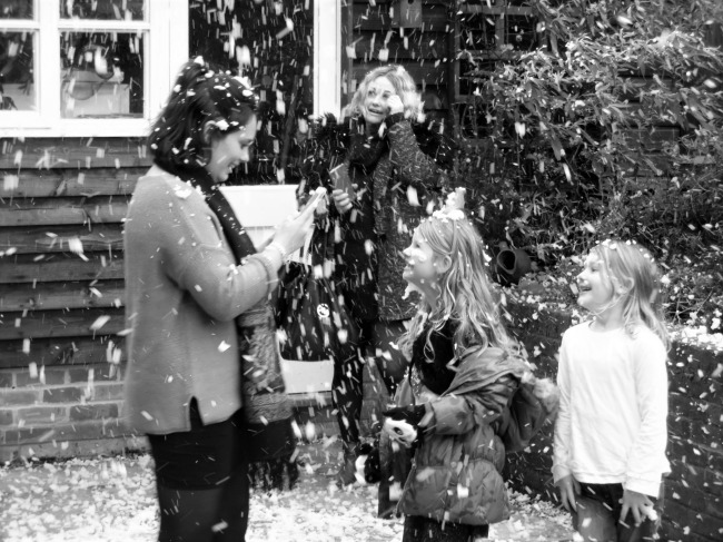 Girls Enjoying Family Time In The Snow