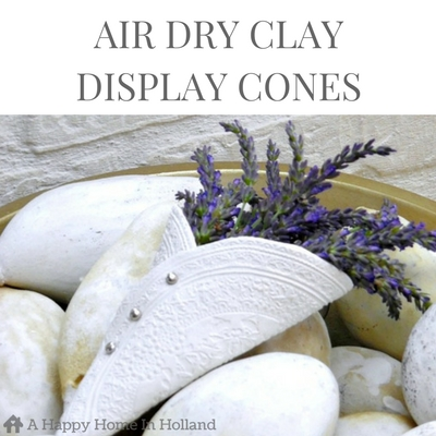 AIR DRY CLAY IDEA - This easy step by step DIY tutorial shows you how to make these beautiful display cones using self hardening clay. Visit http://ahappyhomeinholland.com to see the full project.