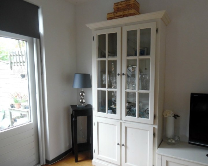 Image of white display cabinet in living room