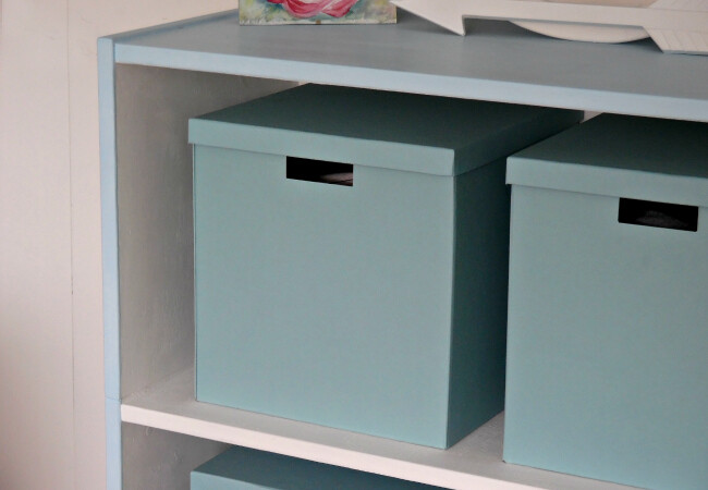 Ikea Storage Boxes Displayed On Blue Bookcase