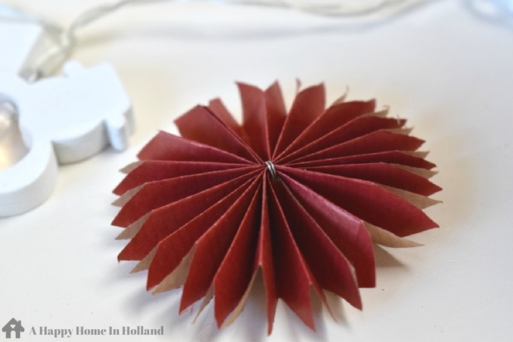 DIY Paper Rosettes - Easy tutorial showing you how to make your own decorative coloured paper fans