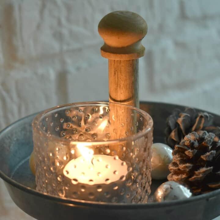 Winter Decor Idea Using Pine Cones & Glass Candle Votives