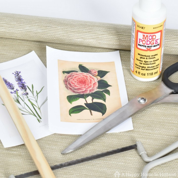 Mod Podge Upcycle Project Idea: Learn how to make your own personalized art wall art using old roller shades and the modge podge photo transfer technique