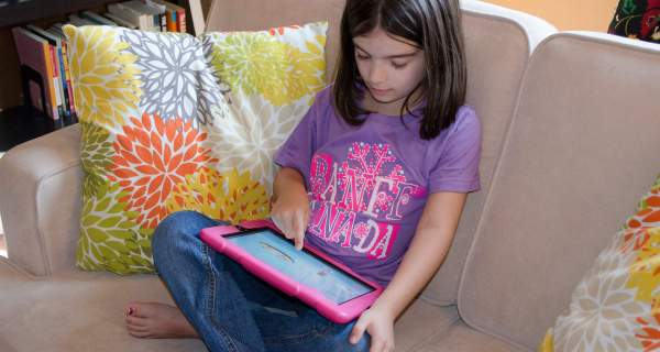 Photo of my 6-year-old daughter using the iPad.