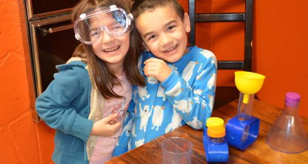 Experimenting with their science kit