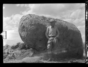 S.H. Knight in front of a rock