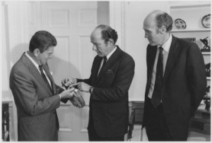 Wyoming Senators, Malcom Wallop and Alan Simpson, present a belt to President Ronald Reagan, August 3, 1981, from the Alan K. Simpson Papers