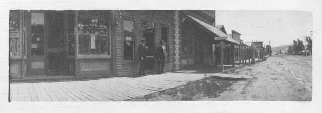 "Payson Spaulding's law office on Main Street in Evanston, WY. Spaulding appears on the right. Payson W. Spaulding papers, Box 96, Folder ""Photographs--Evanston, Wyoming--1904-1936,"" Box 96. American Heritage Center, University of Wyoming."