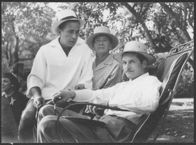 Humphrey Bogart, Clifton Webb, Laurence Olivier at Webb's garden party, ca. 1950