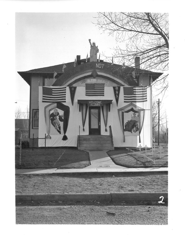 black and white image of house decorated for homecoming