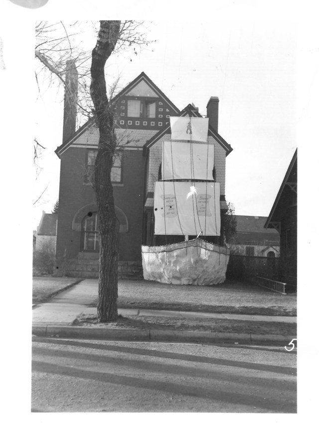 black and white photo of house decorated for homecoming