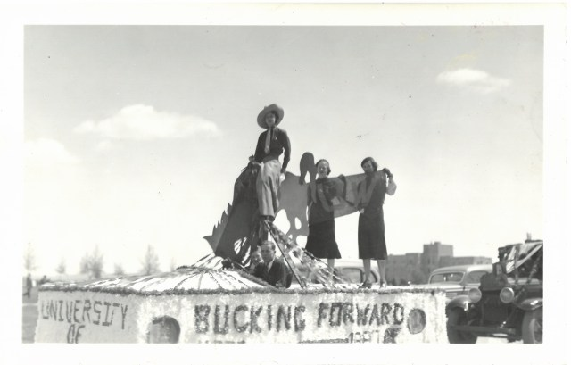 group of people on top of a homecoming float
